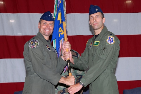 Colonel Eric Theisen, 14th Operations Group commander, passes the 49th Fighter Training Squadron guidon to Lt. Col. Tor Dietrichs in a ceremony July 3. Colonel Dietrichs replaces Lt. Col. Thomas Lennon as commander of the 49th FTS. (U.S. Air Force photo by Melissa Duncan)