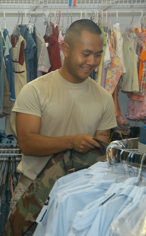 Airman 1st Class Ryan Carrillo, a 55th Aircraft Maintenance Squadron crew chief, browses the wide selection of both uniforms and civilian clothing in the new Airman's Attic building here July 2. (Courtesy Photo)