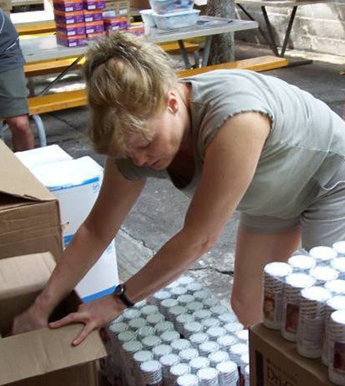 Lt. Col. Maureen Charles, 21st Medical Group women's health nurse practitioner, counts prenatal vitamins in San Miguel, El Salvador. Members of the 21st Medical Group are supporting the Central American exercise as part of an ongoing U.S. Southern Command exercise. (U.S. Air Force photo)