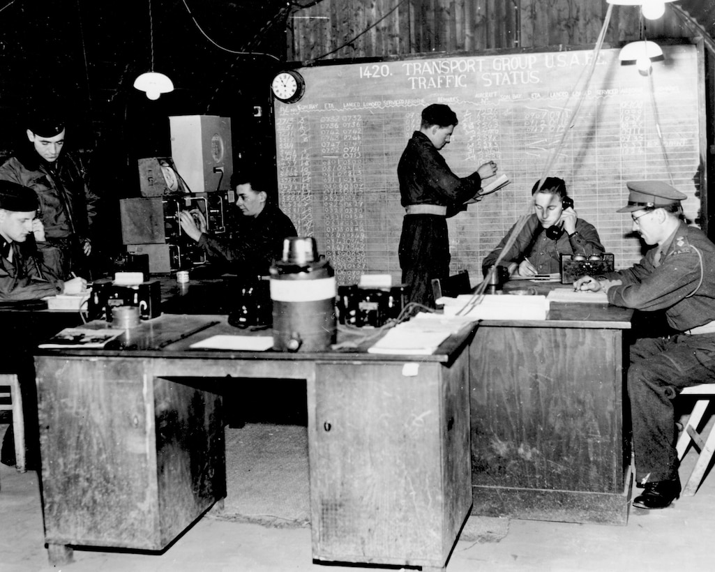 Radio calls from incoming aircraft were monitored by personnel at the traffic control point during the Berlin Airlift in 1948. The traffic control point used this information to help facilitate loading operations. Pictured are from Left to right: Lt. Howard L. Pruden, Lt. Ralph A. Lerch, Driver Peter K. Davis, Driver James Anderson, Lance Cpl. Horton Albert, Capt. Donald Barker. (Courtesy photo)