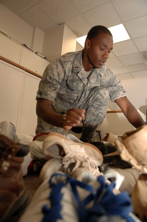 2nd Lt. Brandon Sanders of the 49th Civil Engineer Squadron counts shoes that have been collected so far for the base shoe drive at Holloman Air Force Base, N.M. The shoes will be sent to areas in Africa and Afghanistan where they will be given to those in need.