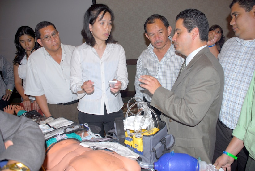 TEGUCIGALPA, Honduras -- Air Force Major Jade Hin teaches a course on airway breathing management July 8 at a Honduran Medical conference in Tegucigalpa. More than 200 medical professional attended the course offered by the Joint Task Force-Bravo Medical Element. Major Hin is deployed from Misawa Air Base, Japan. (U.S. Air Force photo by Staff Sgt. Joel Mease)