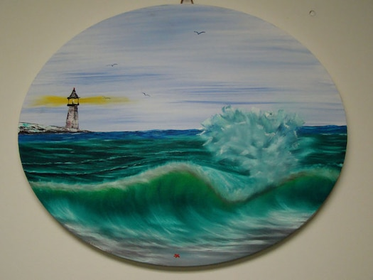 """James """"Trapper"""" Landon, Aerospace Testing Alliance machinist in the Model Shop,  painted this oceanic scene for Stacy Lowe who also works in the Model Shop. (Photo provided)"""