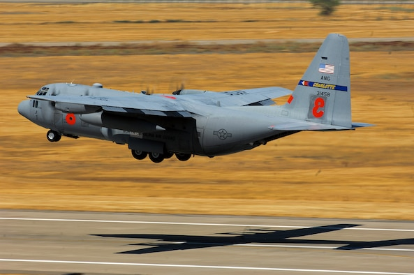 A C-130 Hercules from the North Carolina Air National Guard's 145th Airlift Wing equipped with the modular airborne firefighting system takes off from McClellan Airfield, Calif., on a firefighting support mission.  A continuing heat wave and an ongoing need for aircraft to support ground firefighters will likely keep Department of Defense aircraft very busy for the foreseeable future in support of the national wildland firefighting effort. (U.S. Air Force photo/Staff Sgt. Hector Garcia)