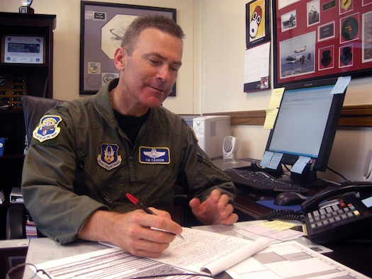 ANDREWS AIR FORCE BASE, Md. -- Col. William T. Cahoon, 459th Air Refueling Wing vice commander, completes work in his office July 11. He takes the reins as wing commander of the 459th Air Refueling Wing Aug. 1, following a change of command ceremony Sunday. (U.S. Air Force photo/Tech. Sgt. Amaani Lyle)