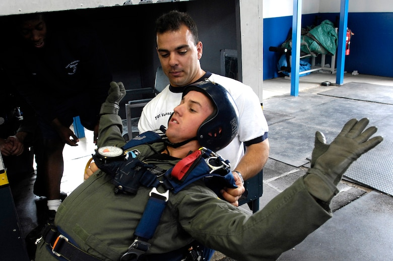 U.S. Air Force Academy Cadet 3rd Class Cody Moorhead receives free-fall techniques training July 7 from Staff Sgt. Joseph Valente, an airmanship instructor, during Airmanship 490, Basic Parachuting, an airmanship program where cadets earn their basic jump wings after successfully completing five free-fall jumps.  (U.S. Air Force photo/Mike Kaplan)