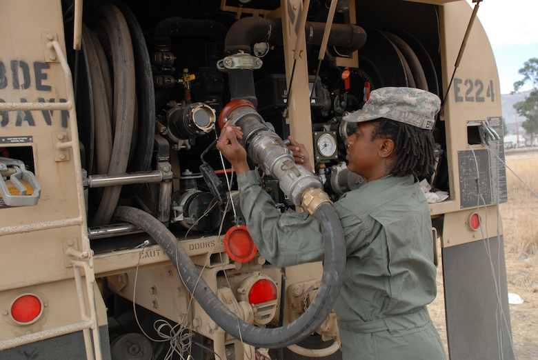 Spc. Linda Edwards, an aircraft refueler deployed from the 5th Battalion, 159 Aviation Regiment out of Fort Eustis, Va., removes a hose from a fuel truck used in support of New Horizons Peru-2008, June 11. (U.S. Air Force photo/Airman 1st Class Tracie Forte)