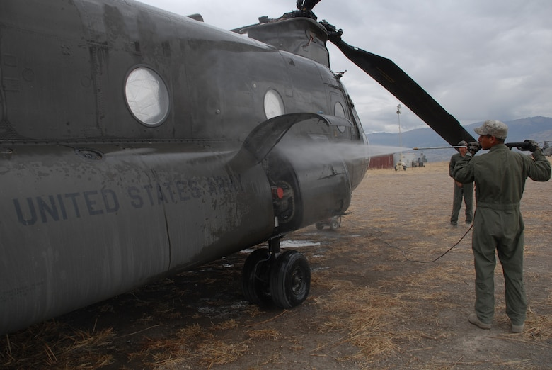 U.S. Army Spc. Josue Coronado-Iglesias, a crew chief from the 5th Battalion, 159 Aviation Regiment out of Fort Eustis, Va., power washes a CH-47 Chinook, currently residing in Los Cabitos, Peru and assigned to Task Force New Horizons Peru-2008, June 11. (U.S. Air Force photo/Airman 1st Class Tracie Forte)