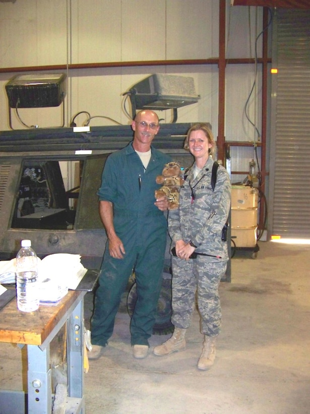 Blabber Bear poses with Technical Sergeant Greg Dennee and LtCol Catherine Hutson. Greg is an Aerospace Ground Equipment Mechanic responsible for the maintenance, troubleshooting and repair of many different pieces of equipment required to maintain, troubleshoot, and repair aircraft of all kinds. Greg has served with the Navy and has been with us for several years and gone on several of our overseas deployments