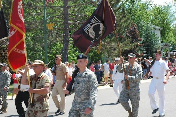 Members of the Veterans of Foreign Wars Post 9084 Color Guard march down  Main Street of fbe35f63c
