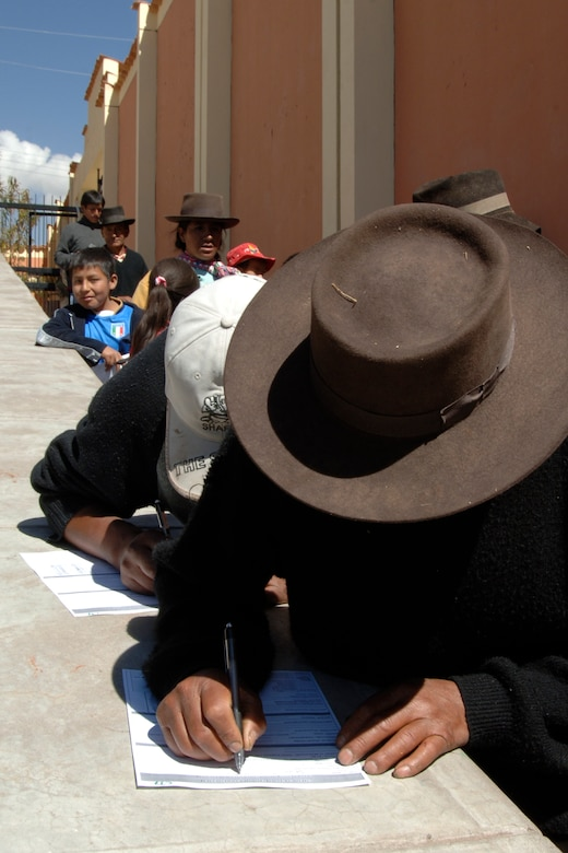 Peruvians seeking medical care fill out forms before seeing physicians, June 30, during a medical mission in Chiara, Peru.  The medical mission is part of a larger effort called New Horizons - Peru 2008, a U.S. and Peruvian humanitarian mission that will bring quality-of-life construction and medical projects to underprivileged Peruvians. (U.S. Air Force Photo/1st Lt. Mary Pekas)