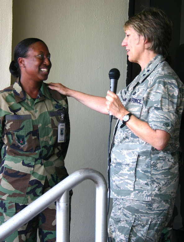 Major General K.C. McClain, Air Force Personnel Center commander here at Randolph Air Force Base, Texas, surprises Master Sergeant Carla Curry, announcing she was selected as one of the 12 Outstanding Airmen of the Year. Sergeant Curry is the superintendant of AFPC's Enlisted Extended Deployment Branch.