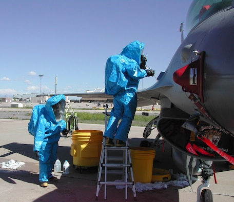 Members of the 140th Aircraft Fuels Systems Repair shop prepare to decontaminate an F-16 during a training exercise June 12.