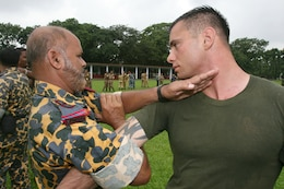 Bangladesh Rifles Senior Warrant Officer S. Damannan applies mechanical advantage control/hold one to Sgt. Corey Gonzalez July 13 during Non-Lethal Weapons Executive Seminar 2008 here. Damannan is a student attending the course. Gonzalez is an assistant anti-terrorism force protection instructor with III Marine Expeditionary Force's Special Operations Training Group.