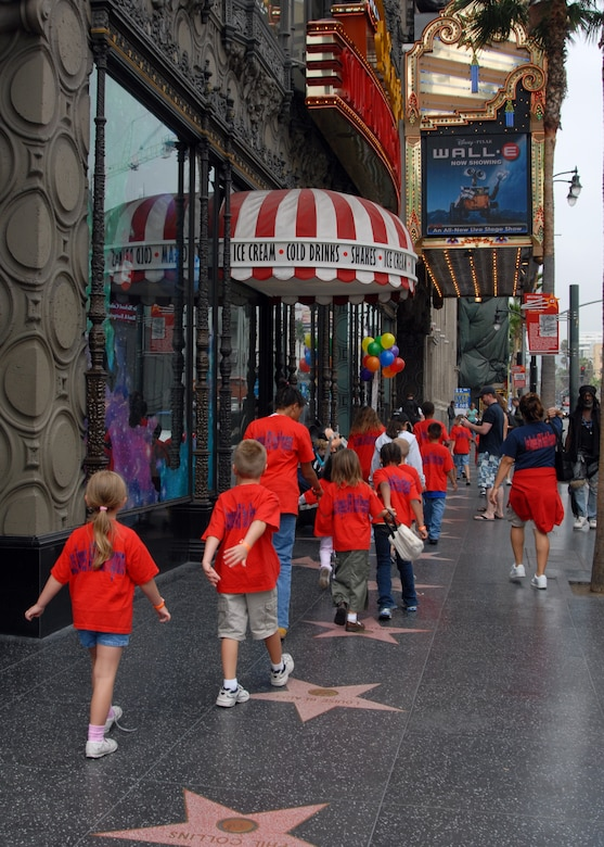 Children from the Los Angeles Air Force Base Youth Center stroll down the Avenue of Stars in Hollywood, Calif., to the El Capitan Theatre to see the newly-released animation, Wall-E.  The trip was part of the Summer Camp 2008 where Youth Center's children participate in a weekly event.  (Photo by Joseph Juarez).
