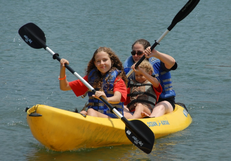 (left to right) Sisters, Kayla and Savannah McCay, and Youth Center counselor, Melissa Callihan, enjoy a day of kayaking and fun at the beach at Mothers Beach in Long Beach as children from the Los Angeles Air Force Base Youth Center took part in Summer Camp 2008.  (Photo by Joseph Juarez)
