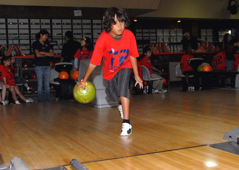 Robert McIntosh eyes the pocket as he prepares to throw the ball during the Los Angeles Air Force Base Youth Center's 2008 Summer Camp kickoff fieldtrip to a bowling alley in Torrance.  The Summer Camp runs through August 29.  Parents can sign up their children weekly to participate in the fieldtrips which include swimming on Tuesdays and Thursday from 1-3 p.m.  For details, call the Youth Center at 310-653-8383.   (Photo by Joseph Juarez)