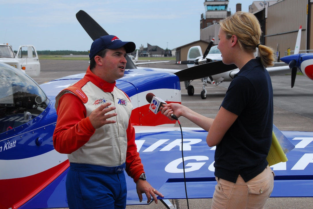 U.S. Air Force Major John Klatt, 148th Fighter Wing Pilot, talks with a local reporter after a flight in the ANG aerobatic demonstration plane over Duluth, Minn. on 14 July, 2008.  John Klatt and the Guarding America, Defending Freedom Aerobatic team will be performing at the Duluth Air Show to promote the Air National Guard 19-20 July, 2008 . (U.S. Air Force photo by Tech. Sgt. Jason W. Rolfe)  (Released)
