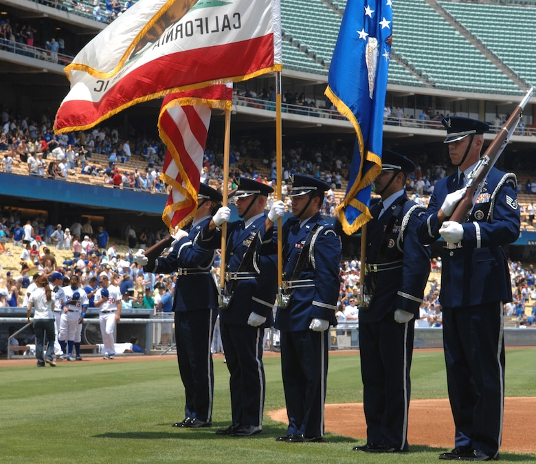 VANDENBERG AIR FORCE BASE, Calif. --  Members of the Vandenberg Honor Guard present the colors at Dodger Stadium in Los Angeles on Sunday. The Dodgers went on to beat the Florida Marlins 9-1. (U.S. Air Force photo/Airman 1st Class Ashley Reed)