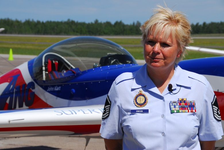 U.S. Air Force Master Sgt. Lisa Erikson, 148th Fighter Wing recruiter, talks with a local reporter about the ANG aerobatic demonstration team in Duluth, Minn. on 14 July, 2008.  John Klatt and the Guarding America, Defending Freedom Aerobatic team will be performing at the Duluth Air Show to promote the Air National Guard 19-20 July, 2008 . (U.S. Air Force photo by Tech. Sgt. Jason W. Rolfe)  (Released)