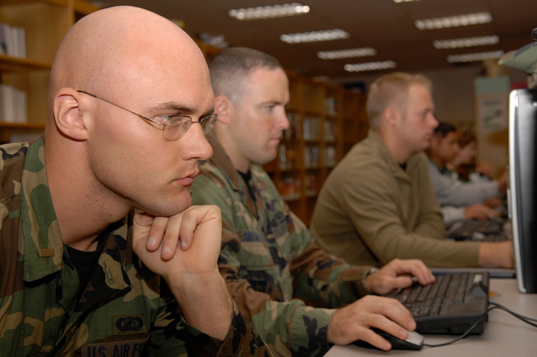 VANDENBERG AIR FORCE BASE, Calif. --  Airmen utilize the computers provided by the base library here. The library is equipped with more than 30 computers, which are available to all eligible library users for general use and commercial email. (U.S. Air Force photo/Airman 1st Class Andrew Satran)