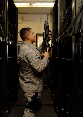 VANDENBERG AIR FORCE BASE, Calif. --  Airman 1st Class Anthony Loch, 30th Security Forces Squadron Bravo Flight Armory, secures a weapon received from Airmen who recently returned from their deployment July 14.  (U.S. Air Force photo/Airman 1st Class Andrew Satran)