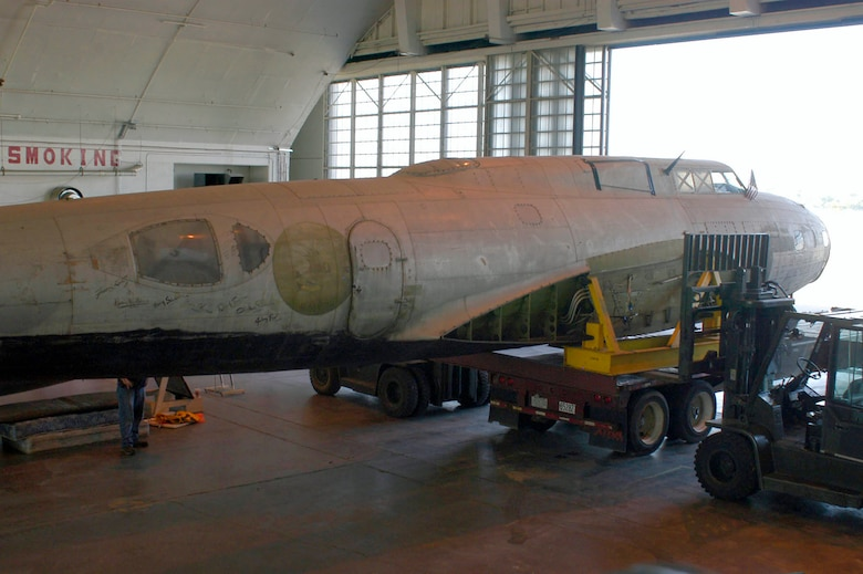 Restoration crews work together to unload the fuselage of the B-17D The Swoose that recently arrived at the National Museum of the U.S. Air Force near Dayton, Ohio, from the National Air and Space Museum in Washington D.C. (U.S. Air Force photo)
