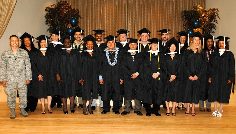 The annual graduation ceremony for Los Angeles Air Force Base's branch of Webster University was held at Fort MacArthur, San Pedro, Calif., and was attended by family, friends, co-workers, and instructors, June 13. The 2008 graduates were:  (1st row, left to right) Maj. Randy Flores, Glenda Watkins, Dormey Blankmann, Diana Dunlap, Capt. Rolando Dagoc, Master Sgt. Anh Pham, *James Scroggins, Staff Sgt. Maria Smith, *Gail Wright, and Jessie Moore, (2nd row, left to right) Nedra Williams, 2nd Lt. Nesta Garner, *Salvador Ramirez, Maj. Donny White, Francis Whalen, Jr., *Ken Merriman, Leonardo Salazar, Felicia Hairrington, Iona Winston. (* indicates graduated with honors.)  Webster University offers degrees in Master of Business Administration, Master of Arts in Management & Leadership, Master of Arts in Procurement and Acquisitions Management, and Master of Arts in Business and Organizational Management. The program is open to all military and civilian employees.  For details, contact the base representative at 310-607-8005.  (Photo by Steven Schester)