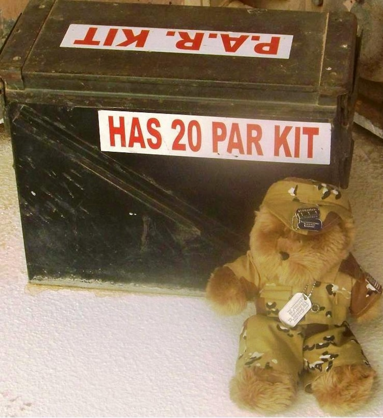 Blabber Bear takes a break near the PAR kit. PAR stands for Post Attack Recovery. This kit has items important to marking and identifying dangerous things such as explosives, missiles or pieces of bombs or rockets that may be in the area. Personnel are trained to do a quick search around the building or shelter for any suspicious items.