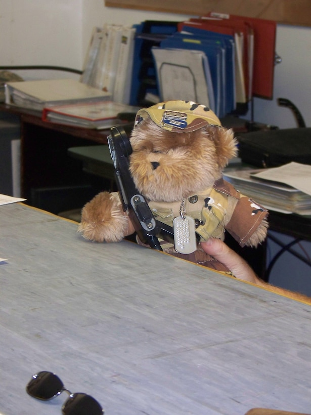 As Blabber Bear demonstrates, talking on the SOF phone to pilots in the air isn't really that hard if you can reach the top of the desk.