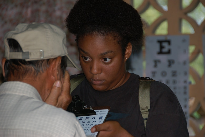 Staff Sgt. Craikista D. Foster a technician from the 42nd Medical Group at Maxwell Air Force Base, Ala., deployed to Medical Readiness Training Exercise (MEDRETE) Panama administers an eye-chart test to a local resident at the Escuela de Cabuya school in Cabuya, Panama 15 July. The MEDRETE is a two-week long U.S. Southern Command sponsored exercise designed to hone the skills of medical personnel while providing free health care in remote locations through partnership with host nation doctors. Approximately 990 patients were seen by the medical staff at the Cabuya location 14-15 July. (Photo by Capt. Ben Sakrisson, Air University Public Affairs)