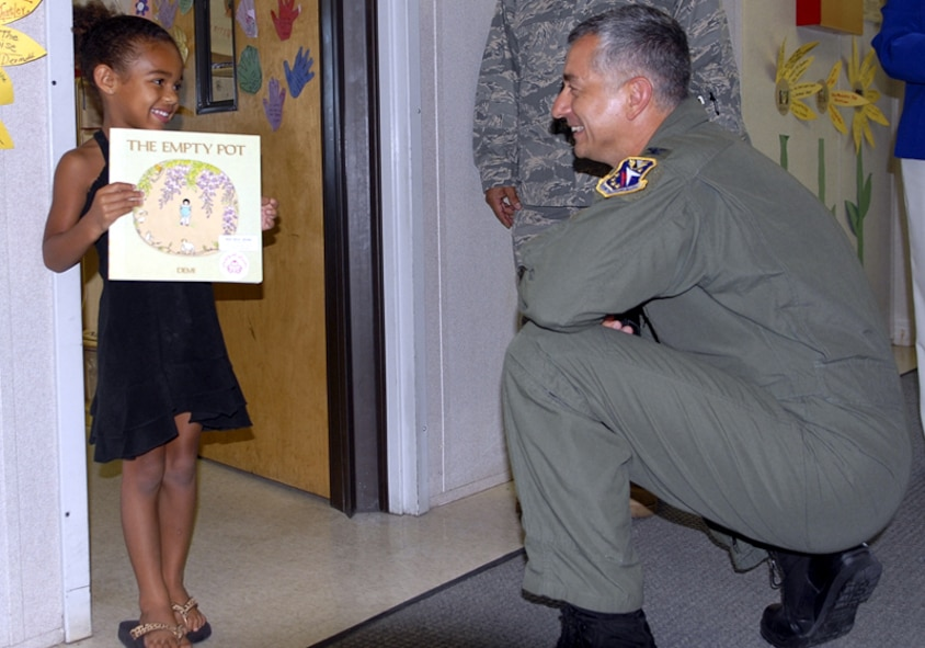 Colonel Roger Watkins, 14th Flying Training Wing commander, interacts with a child at the Columbus AFB Child Development Center during his immersion of the 14th Mission Support Group. (U.S. Air Force photo by Elizabeth Owens)