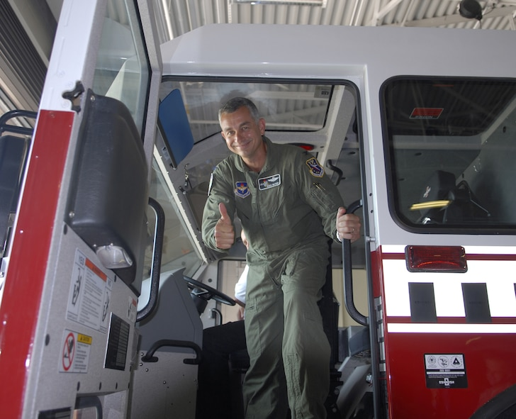 Colonel Roger Watkins, 14th Flying Training Wing commander, tours a fire truck during his immersion of the 14th Mission Support Group at the Columbus AFB fire department. Colonel Watkins was able to have lunch with the firefighters of the 14th Civil Engineer Squadron July 10. (U.S. Air Force photo by Elizabeth Owens)