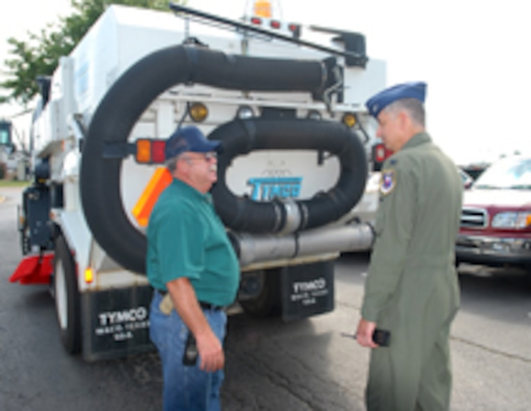 Delbert Lowe, 14th Civil Engineer Squadron, speaks with Col. Roger Watkins, 14th Flying Training Wing commander during Colonel Watkins' immersion of the 14th Mission Support Group. Mr. Lowe drives the street sweeper on Columbus AFB. (U.S. Air Force photo by Elizabeth Owens)