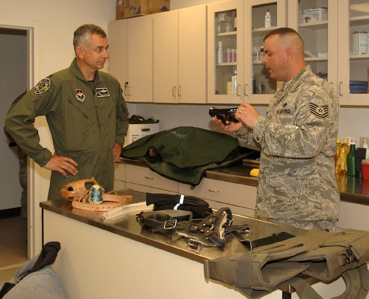 Technical Sgt. Christopher Barnett, 14th Security Forces Squadron, gives Col. Roger Watkins, 14th Flying Training Wing commander, a tour of the Columbus AFB dog kennel during his immersion of the 14th Mission Support Group. (U.S. Air Force photo Elizabeth Owens)