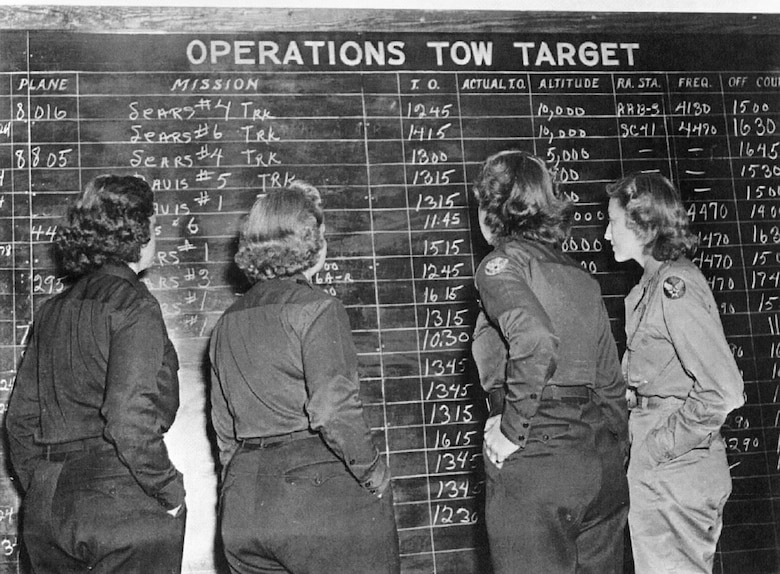 Womens Airforce Service Pilots check the tow schedule. (U.S. Air Force photo)