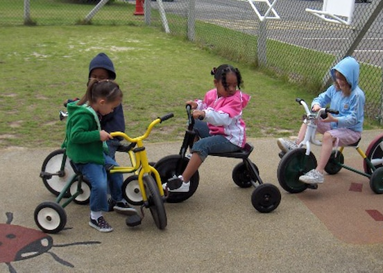 Children from the Mildenhall Child Development Center on RAF Mildenhall play with the CDC's recently refurbished tricycles. The 48th Equipment Maintenance Squadron Aeorspace Ground Equipment flight volunteered to refurbish the tricycles, saving the CDC more than $3,500. (U.S. Air Force photo)