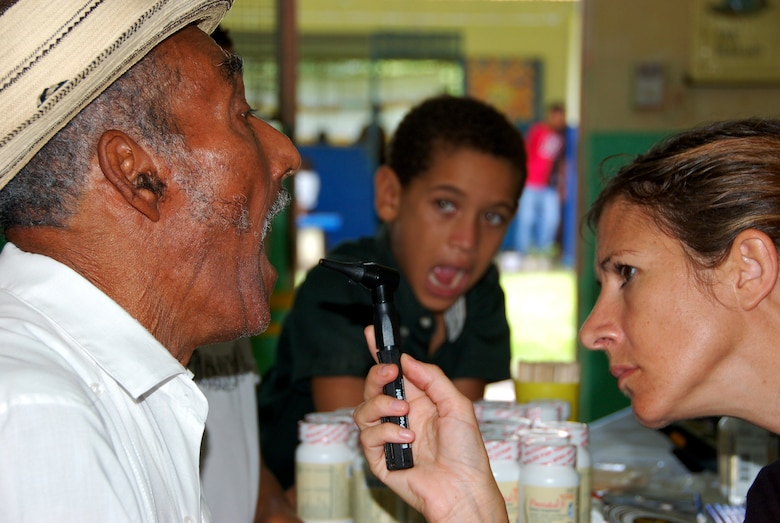 Maj. Mikelle A. Maddox, a family practice doctor here deployed to Medical Readiness Training Exercise (MEDRETE) Panama from the 42nd Medical Group at Maxwell Air Force Base, Ala., checks a patient?s oral health at a school in Santa Maria, Panama 18 July. The MEDRETE is a two-week long U.S. Southern Command sponsored exercise designed to hone the skills of medical personnel while providing free health care in remote locations through partnership with host nation doctors. Approximately 3,100 patients have been seen by the medical staff from 14-18 July. (Photo by Capt. Ben Sakrisson, Air University Public Affairs)