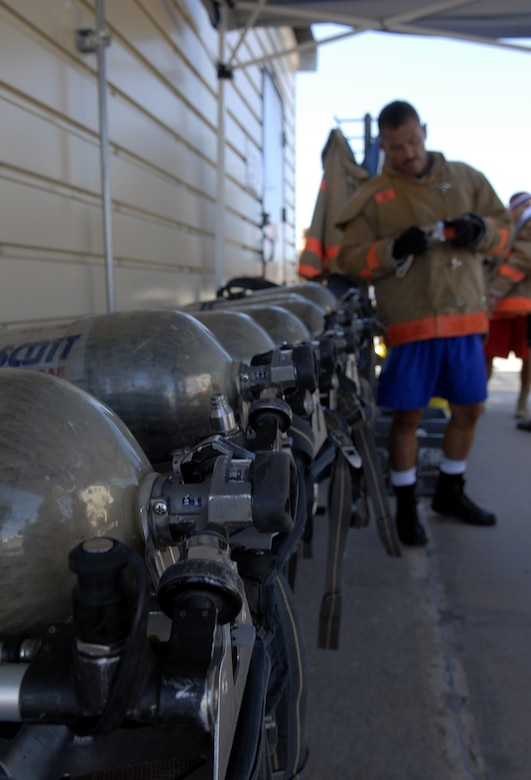 Each participant in the Rookie Firefighter Combat Challenge July 12 wore oxygen packs, which weighed approximately 30 pounds. (U.S. Air FOrce photo by Senior Airman Kamaile Chan)