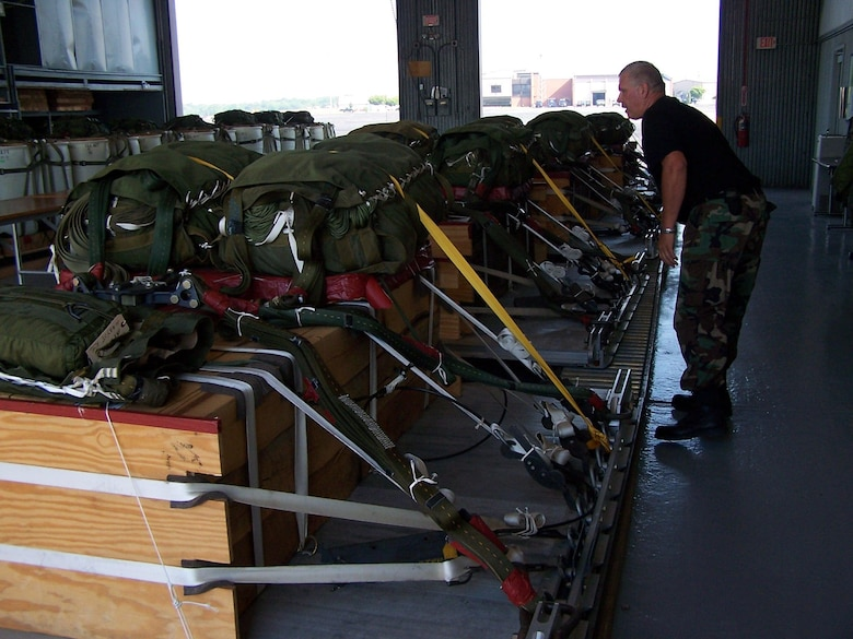 Master Sgt. Ken Grabowski, 166th Aerial Port Flight, Delaware Air National Guard, checks pallet documentaton sheets for heavy equipment loads used for air drop training missions by 166th Airlift Wing C-130 transport aircraft.