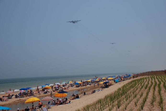 A five-ship large formation of Delaware Air National Guard C-130 transport aircraft from the 166th Airlift Wing in New Castle, Del. in flight heading north offshore from Bethany Beach, Delaware during a 700-mile, three-hour training flight on June 7, 2008 over four states (Del., Md., Va., and N.J.) culminating in an airdrop over Coyle Field, N.J. and a return to home station at New Castle Airport, Del.