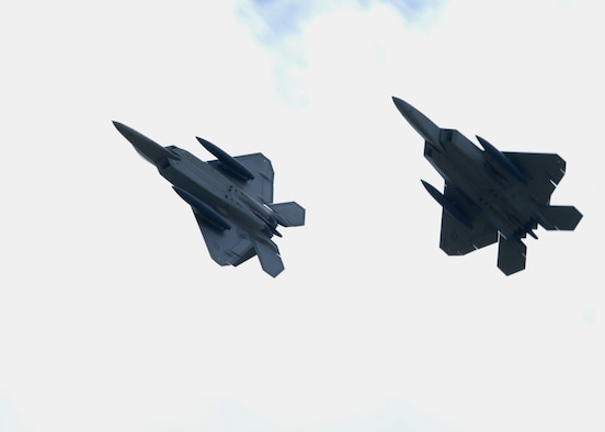 U.S. Air Force F-22A Raptors fly high above Andersen Air Force Base, Guam July 20. Although this is the second time that F-22A's have been deployed to Guam, this is the first time F-22A's assigned to the 90th Expeditionary Fighter Squadron Elmendorf Air Force Base, Alaska have come here. The F-22 Raptor is newest Air Force fighter aircraft. (U.S. Air Force by Airman 1st Class Nichelle Griffiths)