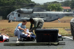Medics tend to patients as a CH-53 Delta from HMH-362 prepares for lift off of a  after dropping off casualties from the USS O'Kane during a mass caualty exercise for the 2008 RIMPAC Exercise here July 21.