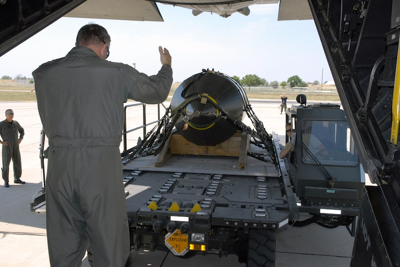 Tech. Sgt. Brian Scott guides the uploading of the last 15,000-pound BLU-82 bomb aboard an MC-130E Talon I shortly before it was dropped July 15 at the Utah Test and Training Range. Sergeant Scott is a loadmaster with the 711th Special Operations Squadron, Duke Field, Fla. (U.S. Air Force photo/Capt. Patrick Nichols)