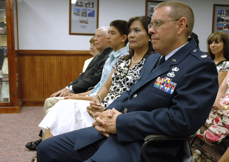 EGLIN AIR FORCE BASE, Fla. -- Lt. Col. Charles Cunningham, Aircraft Maintenance Advisor, HQ Iraqi Air Force, sits with family before being presented with the Bronze Star Medal for meritorious achievements made during his recent deployment. (US Air Force photo/ Airman 1st Class Anthony Jennings)
