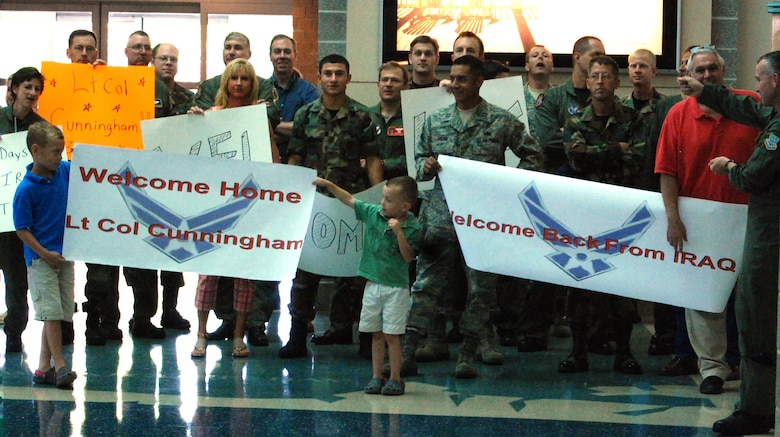 EGLIN AIR FORCE BASE, Fl. -- Lt. Col. Charles Cunningham's family and friends welcome him home after his recent deployment to Iraq which Col. Cunningham received the Bronze Star Medal for the meritorious achievements he made there. (US Air Force photo by Airman 1st Class Anthony Jennings)