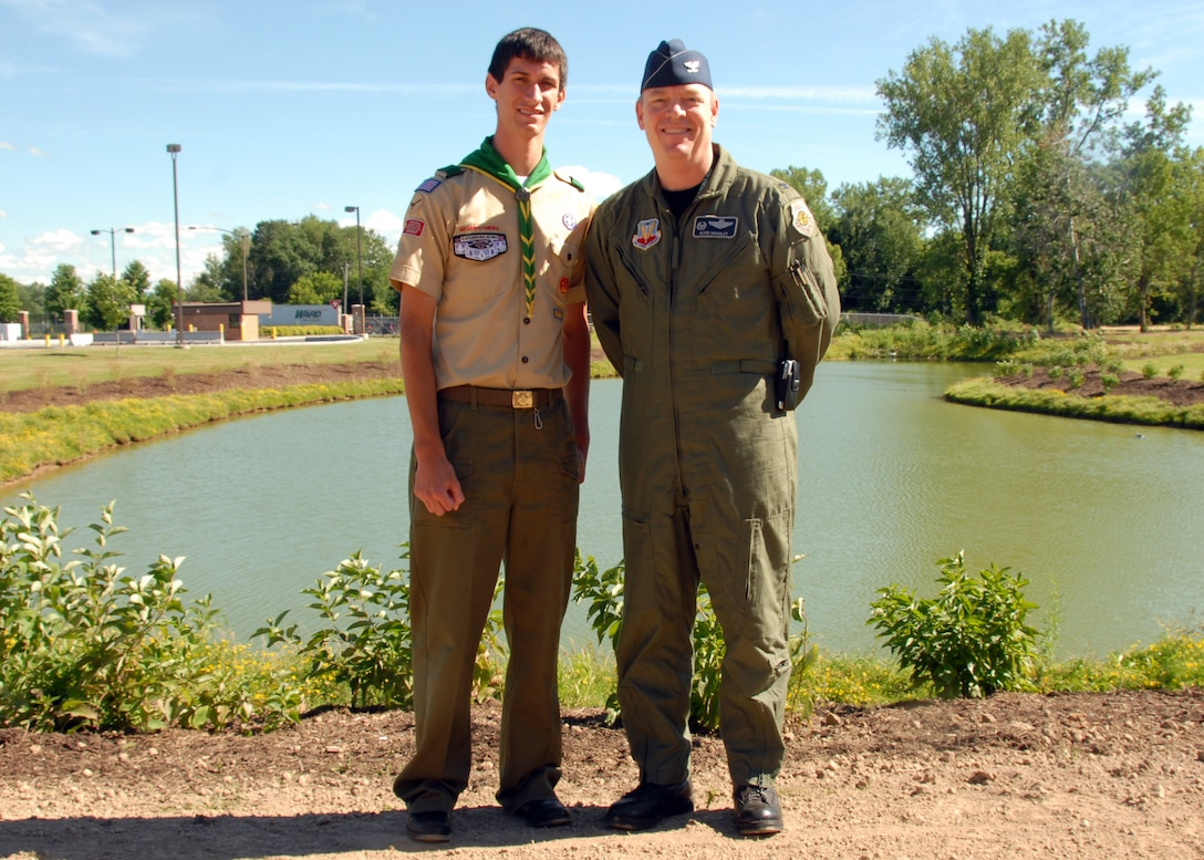 Michael Pizzarri, a member of Scout Troop 220, Syracuse, and 174th Fighter Wing Commander,Col. Kevin W. Bradley, stands at the Bldg 174th cooling pond.  The Eagle Scout candidate performed his Eagle Service Project on Hancock Field by planting 230 shrubs around the pond to mitigate goose populating the pond.