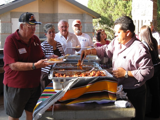 Wayne Wright, Maria and Andy Wolfel, and Frank and Betty Maldonado line up for the feast.