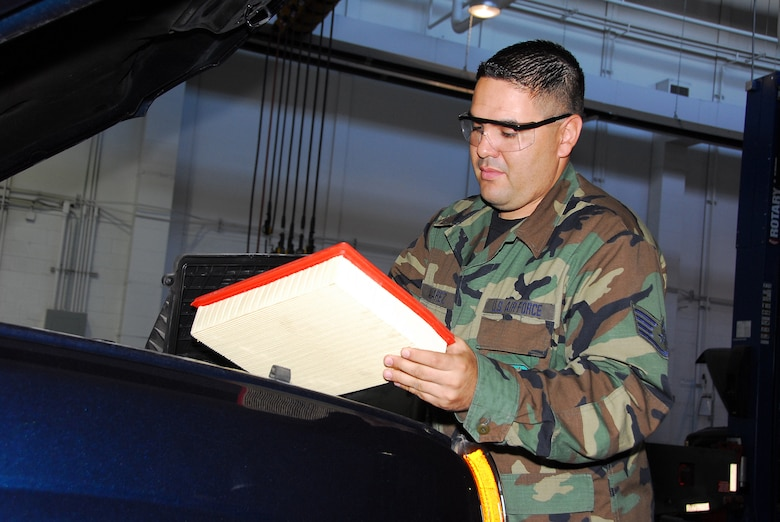 Vehicle Maintenance Mechanic, Staff Sgt. Mario Alvarez, inspects an air filter from a government truck to ensure the vehicle's fuel efficiency. (Air National Guard photo by Master Sgt. David Neve)