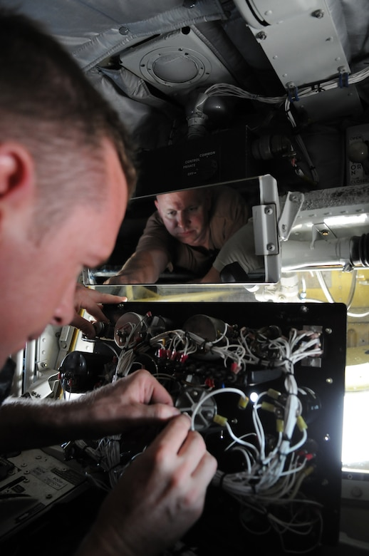 MANAS AIR BASE, Kyrgyz Republic -- Tech. Sgt. Jeremy Metzger, 376th Expeditionary Aircraft Maintenance Squadron, replaces a lighting transformer on a KC-135 during routine maintenance operations. Maintainers, aircrew and support personnel from the 376th Air Expeditionary Wing helped Manas bust through the million pound mark July 17, when the wing's KC-135s offloaded 1.01 million pounds of fuel to an array of aircraft supporting combat operations over Afghanistan. (U.S. Air Force photo / Airman 1st Class Ruth Holcomb)